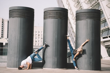 Young contemporary dancers practicing on urban city street