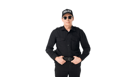 Handsome policeman with hands on belt isolated on white background