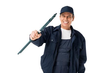 Smiling repairman holding adjustable wrench isolated on white background Stock Photo