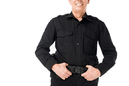 Close-up view of policeman with hands on belt isolated on white background