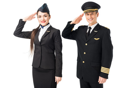 Airline captain and stewardess saluting isolated on white background