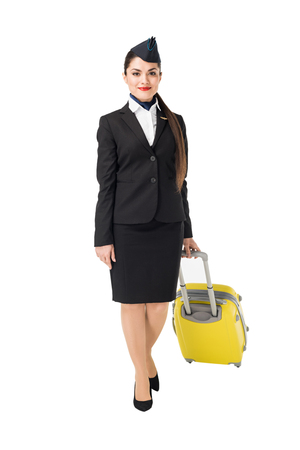 Stewardess in uniform walking with suitcase isolated on white background