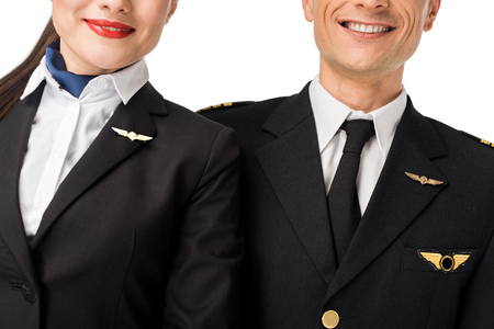 Close-up view of stewardess and pilot in uniform isolated on white background