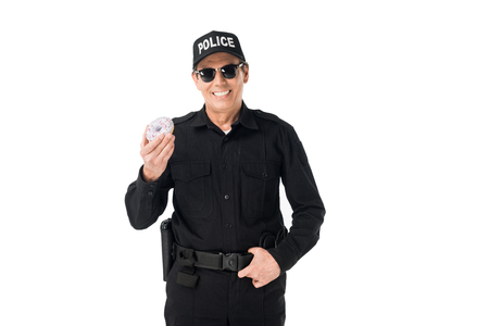 Smiling policeman holding doughnut isolated on white background