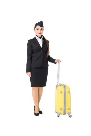 Stewardess in uniform holding suitcase isolated on white background