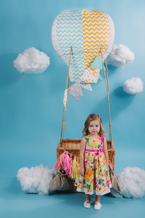 Adorable little child pretending to fly hot air balloon