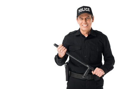 Young policeman with baton looking at camera isolated on white background