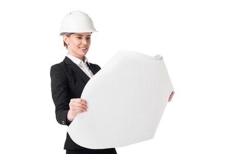 Female construction engineer in suit looking at blueprint isolated on white background