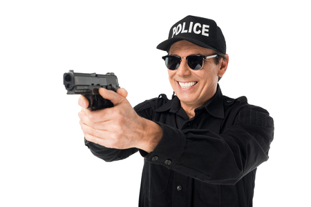 Smiling policeman aiming gun isolated on white background