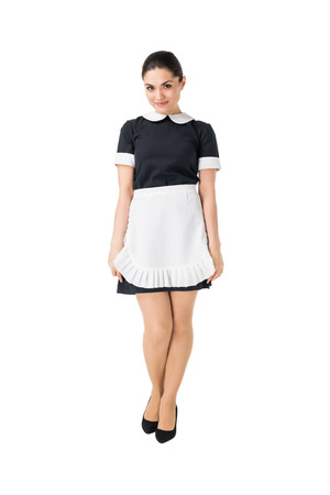 Young maid in professional uniform isolated on white background