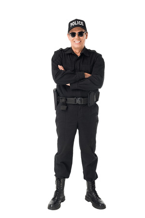 Smiling policeman with arms folded isolated on white background