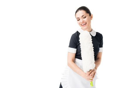 Happy maid singing in duster isolated on white background Standard-Bild