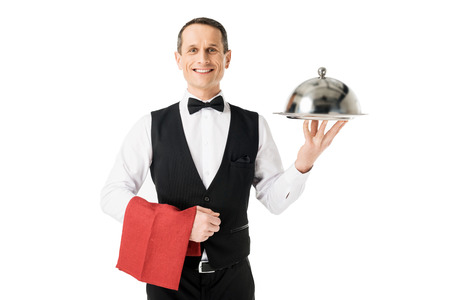 Elegant waiter holding serving tray with cover isolated on white background Foto de archivo
