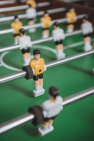 Close up of table soccer with foosball players silhouettes