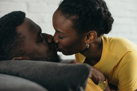 Close-up view of beautiful young African American couple kissing at home Stock Photo