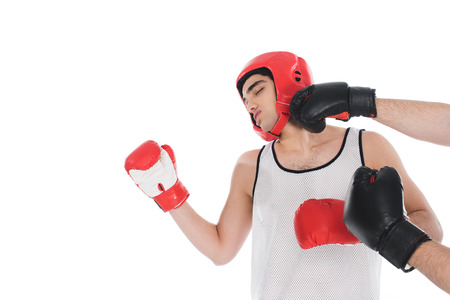 Cropped view of male knocking down boxer by hand isolated on white background 写真素材