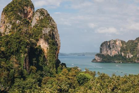Beautiful green plants on cliffs and calm ocean at Krabi, Thailand