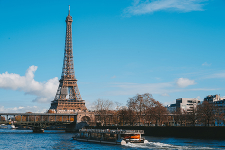 View on Eiffel Tower and boat on river in Paris, France