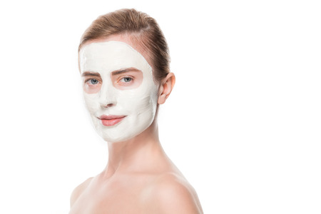 Portrait of woman with facial skincare mask isolated on white background Foto de archivo - 111899825