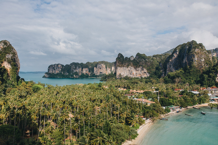 Scenic view of sandy beach with green trees and rocks at Krabi, Thailand Stock Photo