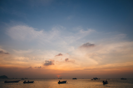 Boats in harbor at sunset, Ko Tao island, Thailand
