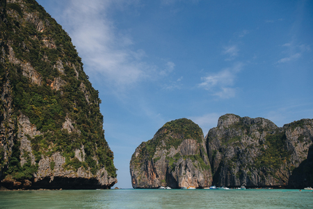 Beautiful cliffs with green vegetation and calm water at Phi-Phi island, Thailand Stock Photo