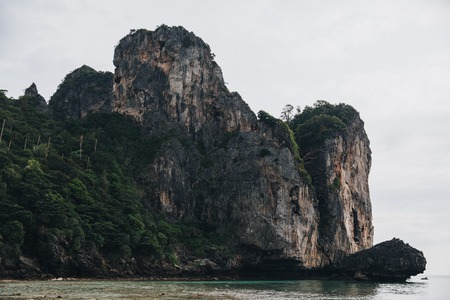 Scenic cliffs with green vegetation and transparent water at Phi-Phi island, Thailand Stock Photo