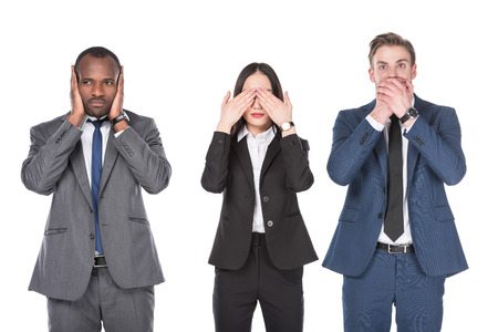 Portrait of multicultural young business people covering parts of faces isolated on white background