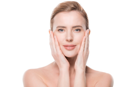 Woman with fresh clean skin touching own face isolated on white background