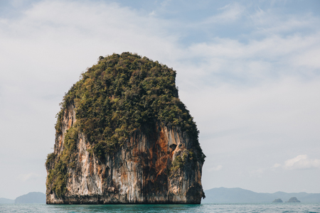 Majestic landscape with cliff in calm ocean at Krabi, Thailand Stock Photo