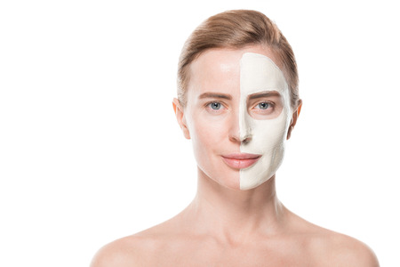 Woman with facial skincare mask isolated on white