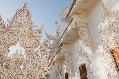 Decorative statues on Wat Rong Khun White Temple, Chiang Rai, Thailand