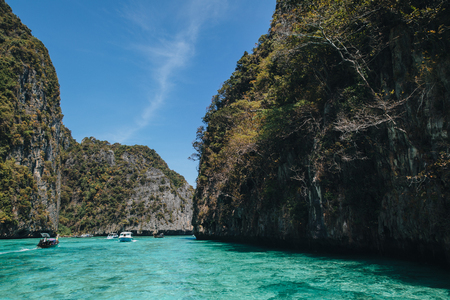 Boats floating on transparent blue water at Phi-Phi island, Thailand