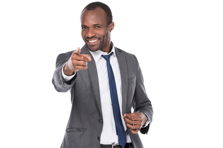 Portrait of smiling African American businessman pointing at camera isolated on white background Imagens