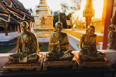Golden religious statues in ancient temple at Chiang Mai, Thailand Stock Photo