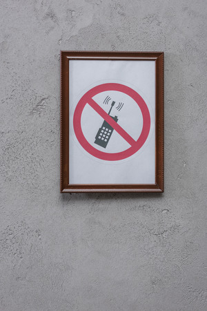 Restricted phone placard on concrete wall background