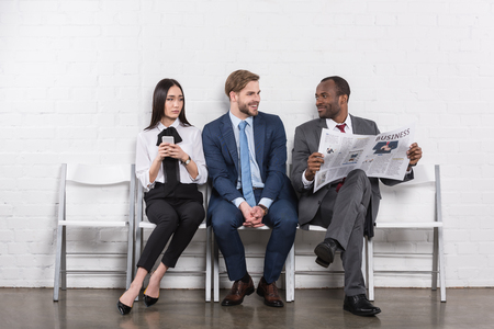 Multiethnic young business people waiting for job interview Stockfoto