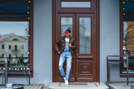African American boy wearing casual clothes standing by door