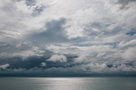 Cloudy sky above calm ocean, Krabi, Thailand