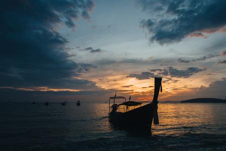 Boats in harbor at sunset, Krabi, Thailand