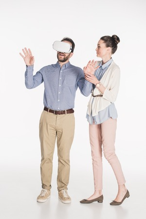 Man in virtual reality headset with wife near by isolated on white background 免版税图像