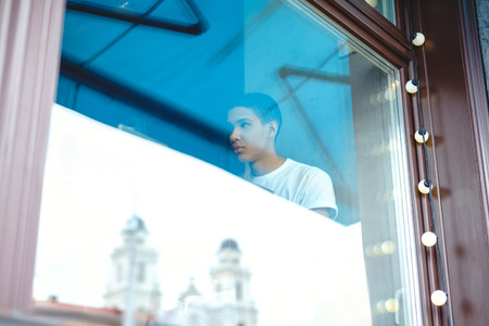Through glass view of attractive African American man