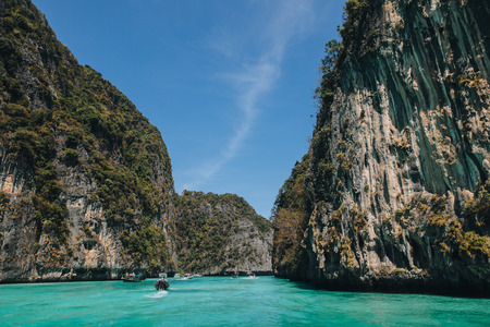 Ships floating on transparent blue water at Phi-Phi island, Thailand