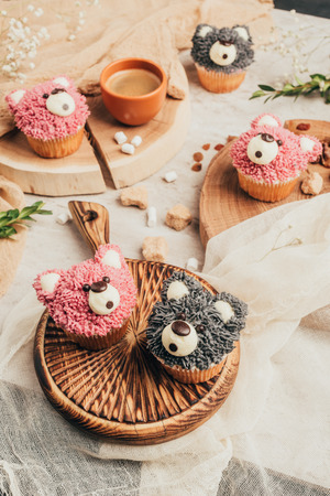 Close-up view of delicious sweet cupcakes in shape of bears on table Stok Fotoğraf