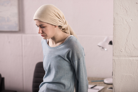 Portrait of upset sick young woman in kerchief, cancer concept Stok Fotoğraf