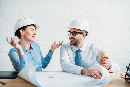 Experienced architects working with building plan at office Stock Photo