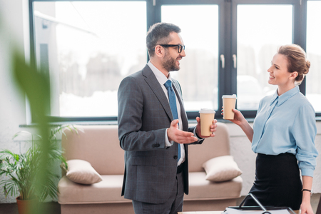 Business people having chit-chat while drinking coffee at office