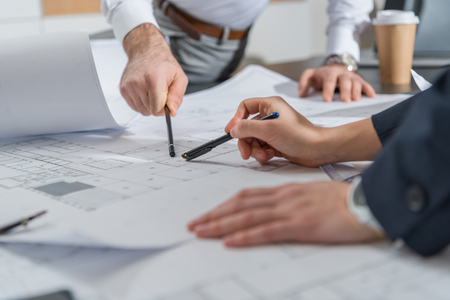 cropped shot of architects working with building plans together at office Stock Photo