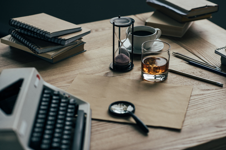 Close-up shot of writer workplace with whiskey glass and typewriter Reklamní fotografie