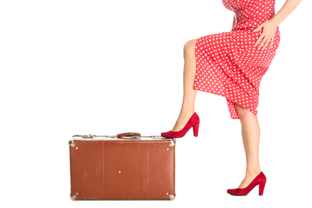 Cropped shot of woman with vintage suitcase isolated on white background